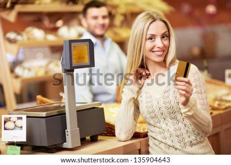 Attractive girl with a credit card - stock photo