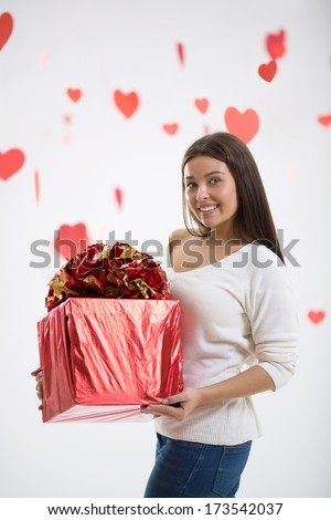 Attractive girl with a gift - stock photo