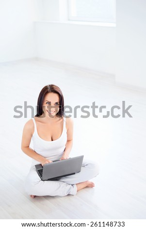 Attractive girl with a laptop - stock photo