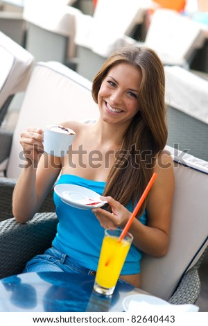 attractive girl with coffee and orange soda - stock photo