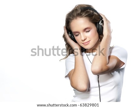 attractive girl with headphones on white background - stock photo