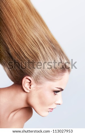 Attractive girl with long hair - stock photo