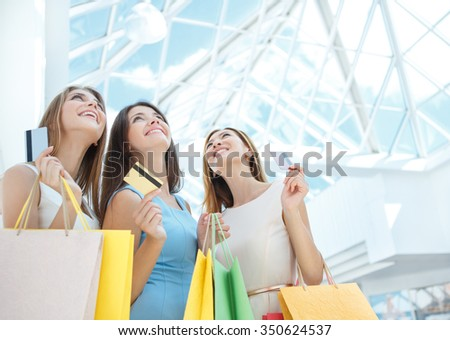 Attractive girls with a credit card - stock photo