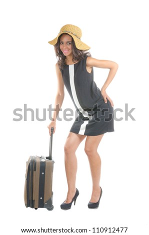 Attractive happy traveler  woman with suitcase. Isolated on white. - stock photo
