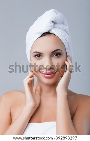 Attractive healthy girl is making facial treatment - stock photo