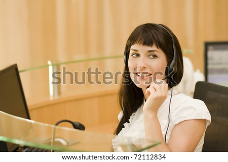 attractive helpdesk woman talking to customers - stock photo
