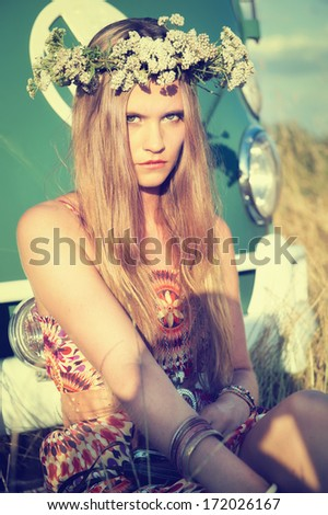 attractive hippie girl with floral wreath - stock photo