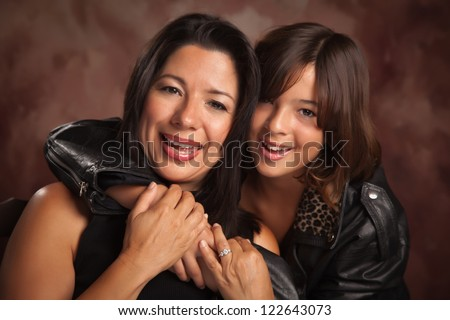Attractive Hispanic Mother and Daughter Studio Portrait. - stock photo