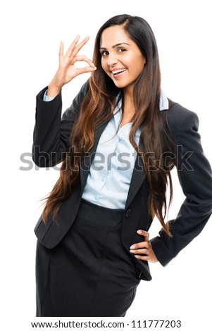 Attractive Indian businesswoman okay sign isolated on white background - stock photo