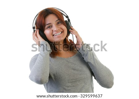 Attractive Indian woman listening to music on headphones - stock photo