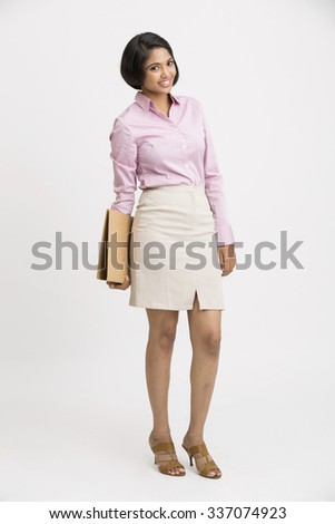 Attractive Indian young business woman holding document on white background. - stock photo