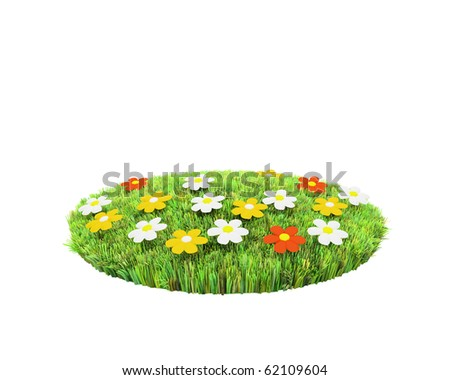 attractive islet of green grass with flowers - stock photo