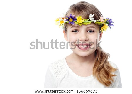 Attractive Kid wearing flower wreath - stock photo