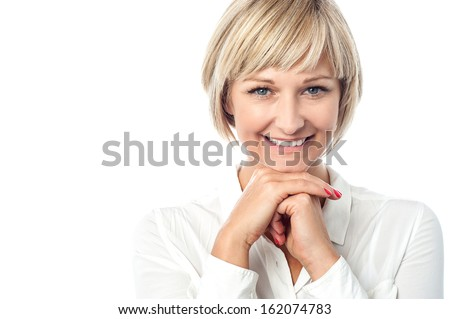 Attractive lady posing with a radiant smile - stock photo
