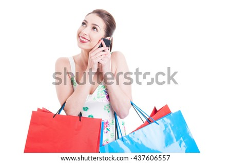Attractive lady shopper at phone smiling and acting happy isolated on white with copy space text area - stock photo