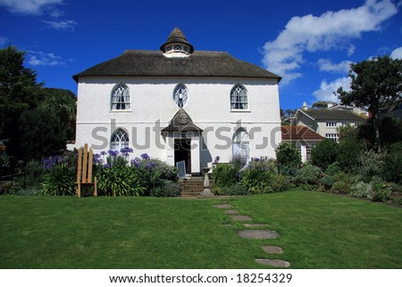 Attractive large whitewashed and thatched house in Devon England - stock photo
