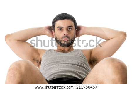 attractive latin american sport man wearing running clothes doing a sit up or crunch working this abs isolated on a white background in fitness , body building and healthy lifestyle concept - stock photo