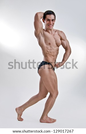 Attractive male body builder, demonstrating contest pose - stock photo