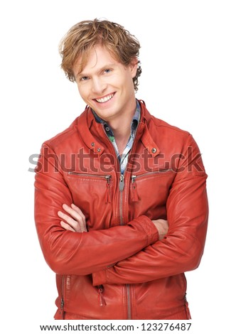 Attractive male fashion model wearing a red leather jacket looking at camera and with a smile expression on his face. Isolated on white background - stock photo