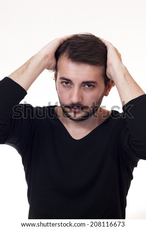 attractive male looking and fixing his hair  - stock photo
