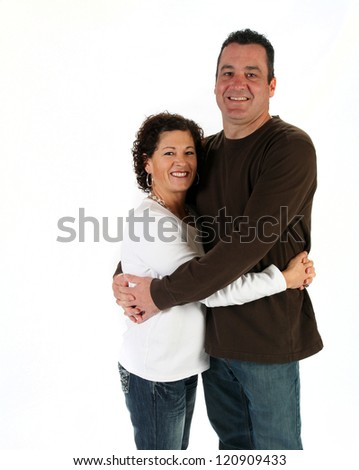Attractive man and woman standing together on white background - stock photo