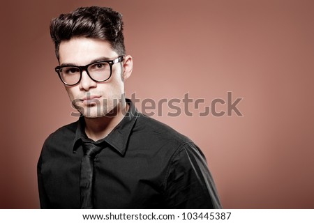 attractive man dressed casual wearing glasses - studio shot, copy space - stock photo