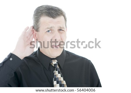Attractive man gesturing that he cannot hear - stock photo