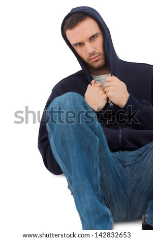 Attractive man looking sad on white background - stock photo