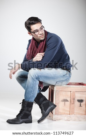 attractive man posing in the studio dressed casual wearing eye glasses - stock photo