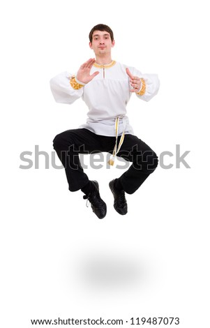 Attractive man wearing a folk russian costume dancing against isolated white background - stock photo