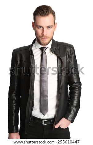 Attractive man wearing a white shirt, black tie and a black leather jacket. White background. - stock photo
