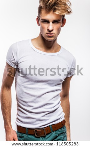 Attractive man wearing t-shirt - close up portrait on white background. - stock photo