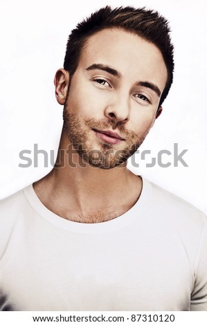 Attractive man wearing T-shirt close up portrait on white background. - stock photo
