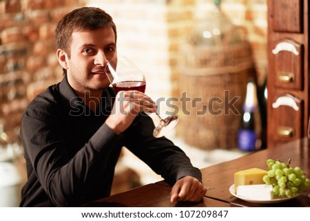 Attractive man with a glass of wine - stock photo