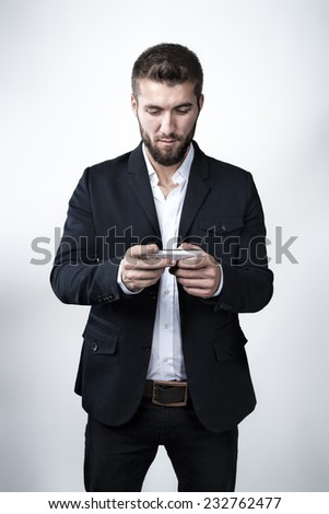 Attractive man with a mobile phone - stock photo