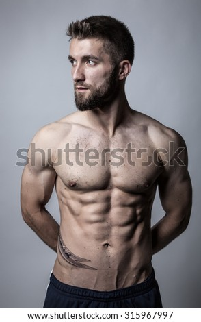 Attractive man with strong abdominal muscles - stock photo