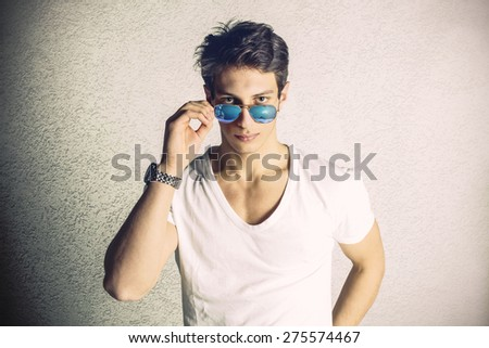 Attractive man with sunglasses - stock photo