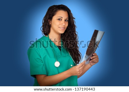 Attractive medical with a radiography on blue background - stock photo