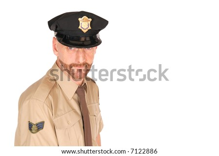 Attractive, mid fifties bearded police officer wearing kepi, firm expression on face - stock photo