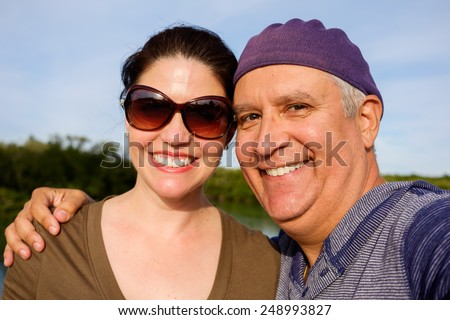 Attractive middle age couple outdoor portrait. - stock photo