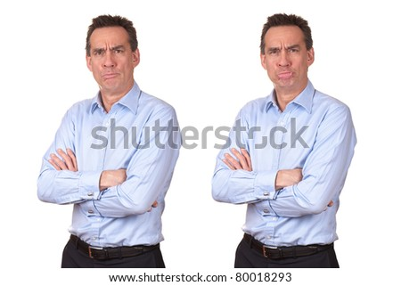 Attractive Middle Age Man in Blue Shirt with Grumpy Unhappy Expression and Wobbly Lower Lip with Arms Folded - stock photo