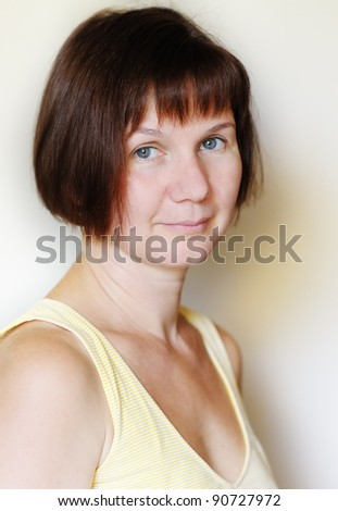 Attractive middle age woman, indoors portrait - stock photo
