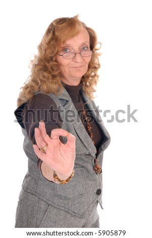Attractive middle aged blond businesswoman  giving okay sign, white background, - stock photo