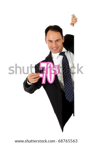 Attractive middle aged caucasian businessman behind a wall showing seventy percent discount sign. Copy space. Studio shot. White background. - stock photo