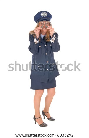 Attractive middle aged female police officer with handcuffs in front of face. White background - stock photo