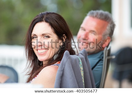 Attractive middle-aged man and woman outside - stock photo