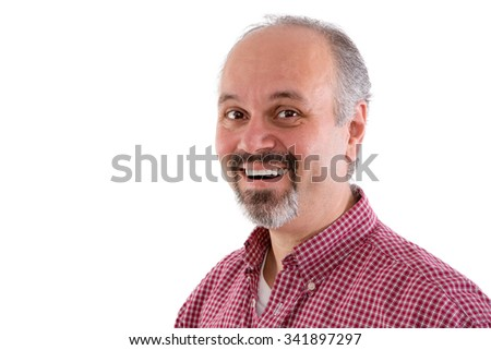 Attractive middle-aged man with a goatee wearing a red checkered shirt and a lovely friendly smile looking sideways at the camera, head and shoulders isolated on white - stock photo