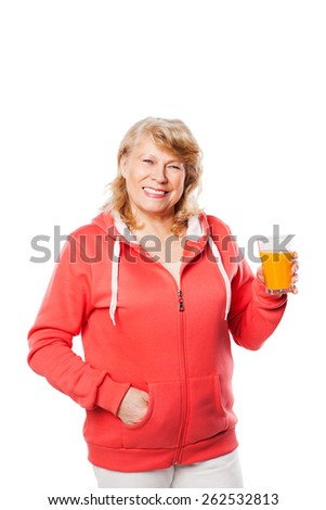Attractive middleaged smiling woman with a glass of juice - stock photo