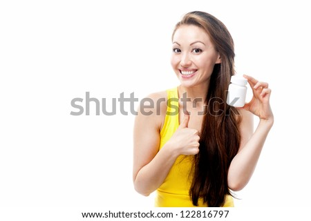 Attractive Mixed Asian female holding a white supplement bottle with thumbs up - stock photo