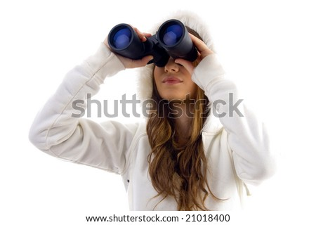 attractive model watching through binocular on an isolated white background - stock photo